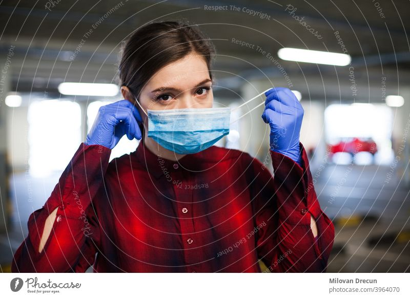 Woman putting mask on adult attractive bacteria blue care caucasian contagious corona coronavirus covid-19 danger disease epidemic equipment face female flu