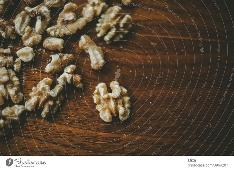 Walnuts on wood Wood Food salubriously Snack Rustic peeled shelled