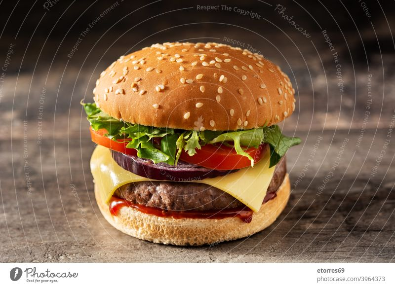 Cheeseburger with beef,tomato, lettuce and onion american barbecue bread cheese cheeseburger classic closeup delicious dinner fast food grilled hamburger