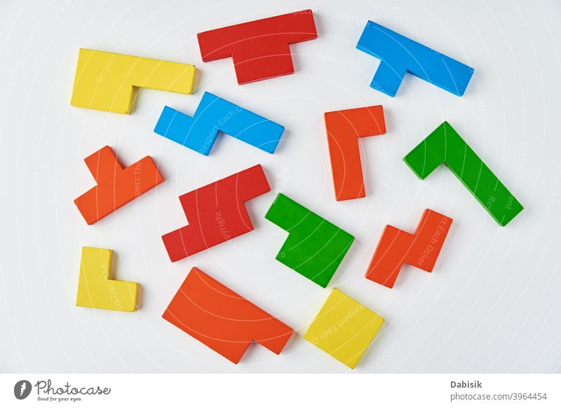 Different wooden blocks on white background. Concept of logical thinking and education puzzle geometric concept creative abstract business colorful connect
