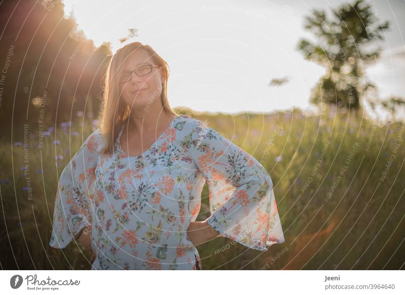 Young woman smiling friendly | Sunny summer evening with blue cornflowers in background | Portrait 30 - 45 years Woman feminine Smiling smilingly smiling woman