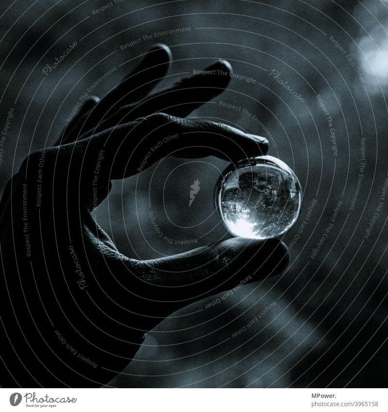 look into the crystal ball Glass ball Hand Round Pane stop Mirror image Black & white photo Reflection Shallow depth of field Light (Natural Phenomenon)