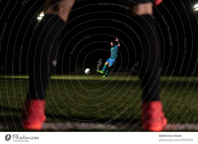 Soccer player kicking ball on field football soccer game goal match sport goalkeeper men rival competition training athlete stadium activity professional power