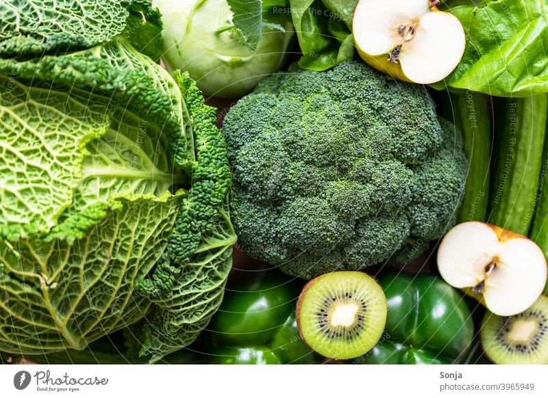 Top view of green raw vegetables and fruits Vegetable Green Raw Vegetarian diet Organic produce Healthy Vegetable market Fresh Farmer's market Greengrocer