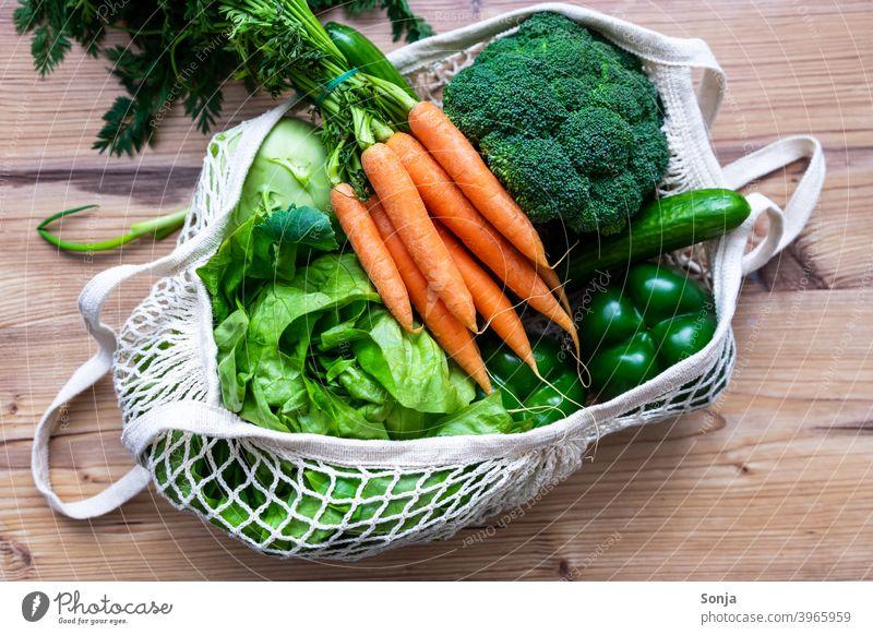 Fresh raw vegetables in a reusable shopping bag Vegetable Raw Carrot Lettuce Broccoli Diet Vegetarian diet Healthy regionally mesh pocket Shopping bag Reusable