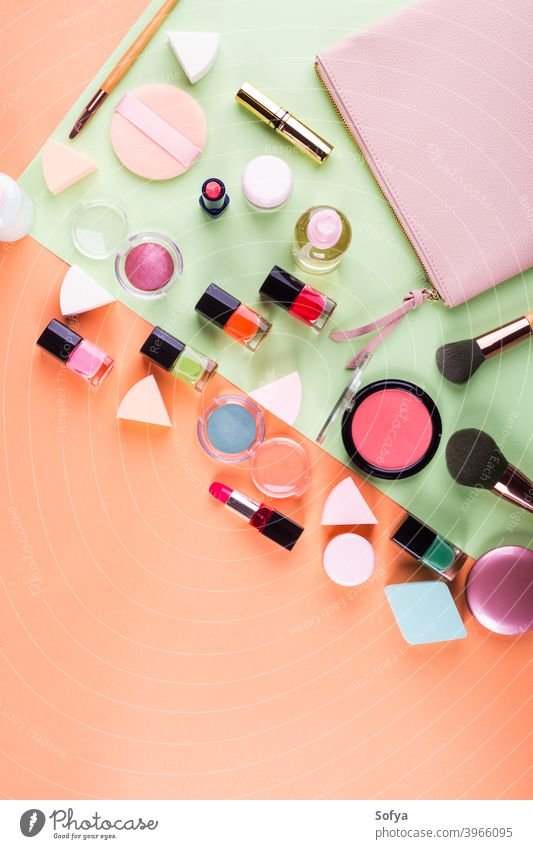 Make up accessories on orange and green. Flat lay make up flat lay beauty products fashion color pink cantaloupe woman mint design geometry face nail polish