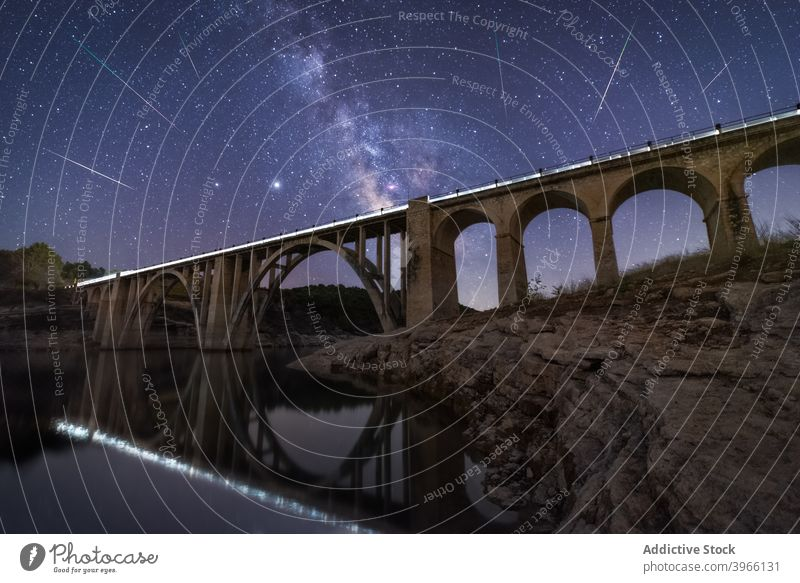 Viaduct under starry sky at night viaduct landscape bridge spectacular milky way galaxy dark glow illuminate light sparkle dusk astronomy scenic shiny luminous