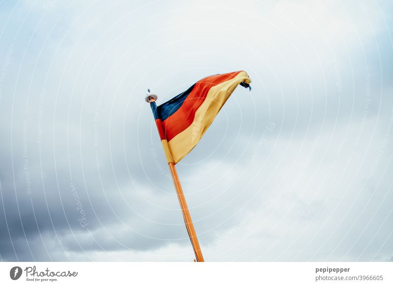 German flag German Flag Germany Patriotism Ensign Red Black Gold Politics and state Exterior shot Colour photo Wind Blow Pride Day Deserted Flagpole