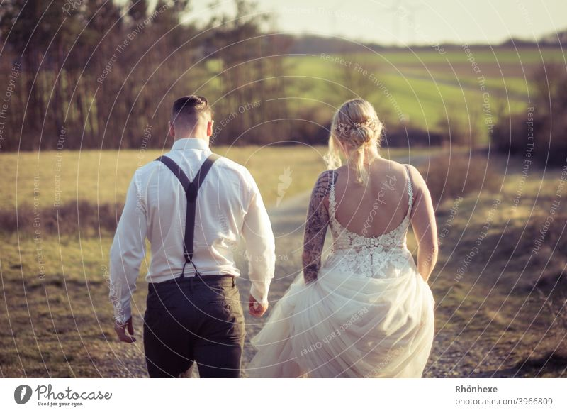 Together towards married life Wedding Colour photo Exterior shot Love Happy Couple Partner Adults Woman Day Wedding dress Wedding couple Man Dress 2 Loyalty
