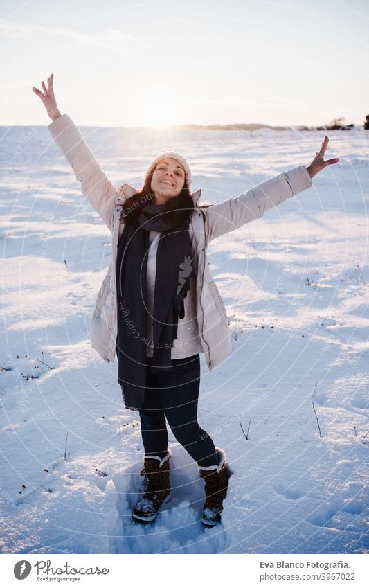 happy young woman hiking in snowy mountain wearing modern coat at sunset. winter season. nature cold caucasian forest wanderlust travel walk hiker tour tourism