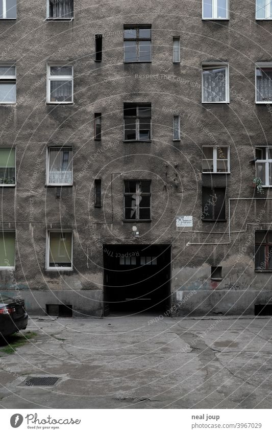 Grey and drab backyard facade of a residential building Architecture dwell block of flats Gloomy Old Facade Building House (Residential Structure) Town urban