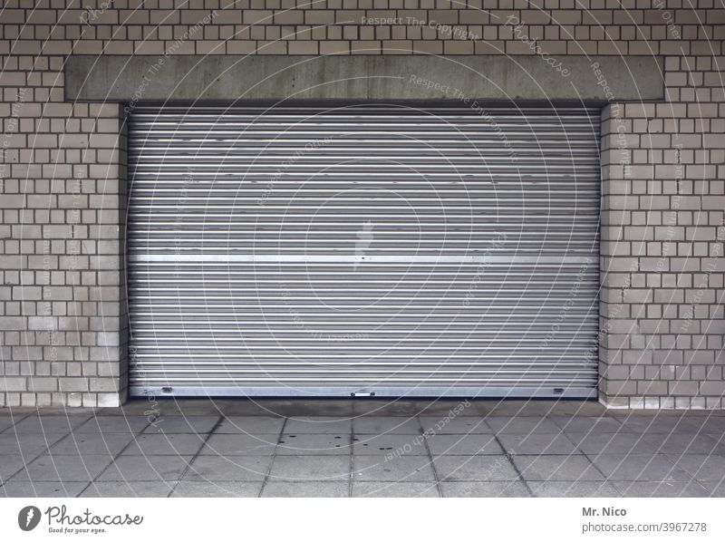 roller shutter Goal Storage Warehouse Depot Building Closed Gloomy Rolling door Stock of merchandise Gray Garage Garage door Please keep driveway clear