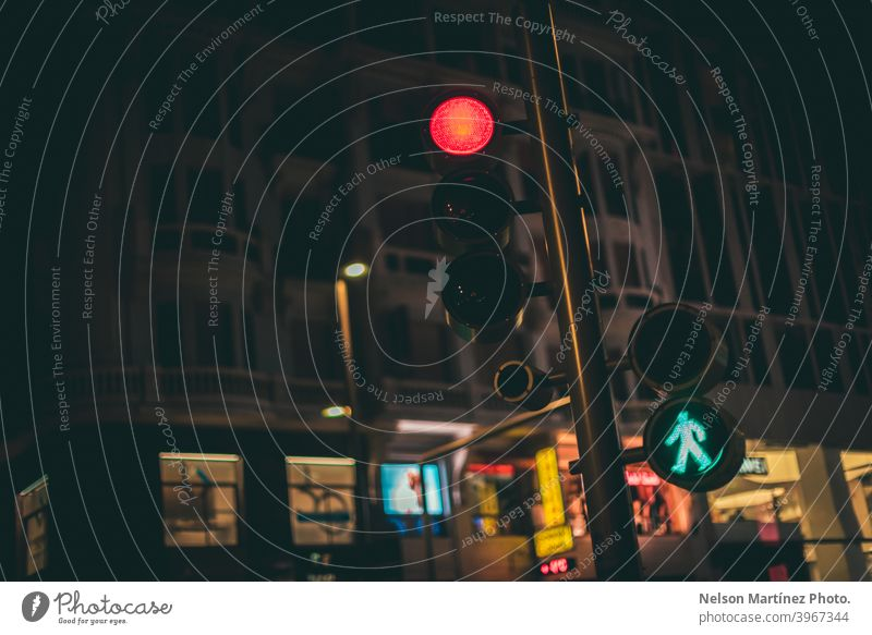 Low angle shot of a traffic light in the street at night. road urban yellow city landscape driving colours transport outdoors car travel blur dusk bokeh view