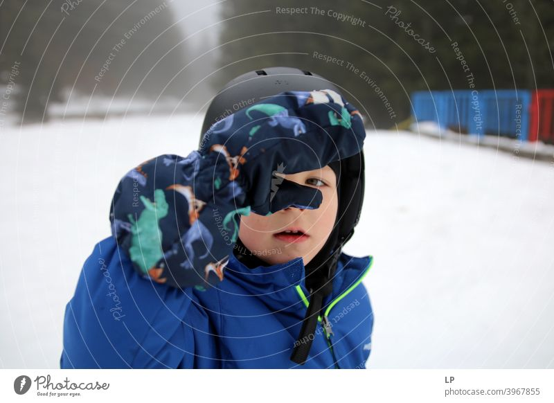 little child looking at the camera in a winter landscape rebellion Rebel Child people Language concept positive Expression symbol directly Conceptual design