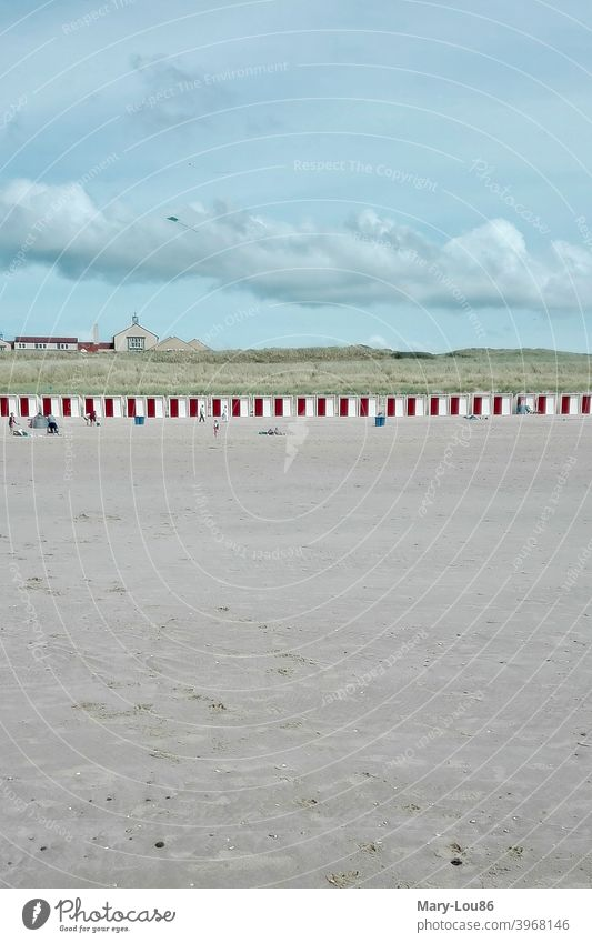Beach with red changing rooms Deserted wide changing cubicle Clouds cloudy Ocean Sand To go for a walk Water coast Vacation & Travel Landscape Exterior shot