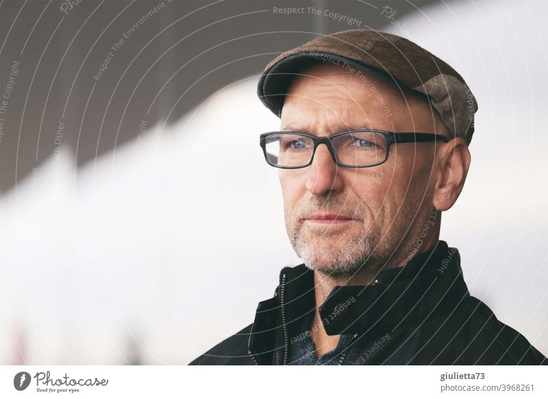 Portrait of a thoughtful man with glasses, cap and grey three-day beard [UT HH 19 Day Human being 45 - 60 years Eyeglasses Gray-haired Observe Senior citizen