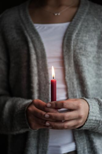 A single red burning candle held by a girl Candle flame shoulder stand hands hold in one's hands Light devout Cozy Burn Warmth Advent Christmas Pensive hygge