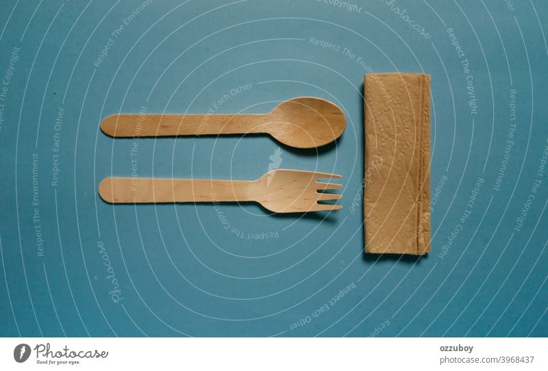 flat lay wooden spoon and fork isolated on blue background utensil tool equipment brown kitchen object traditional cooking natural cutlery new set domestic