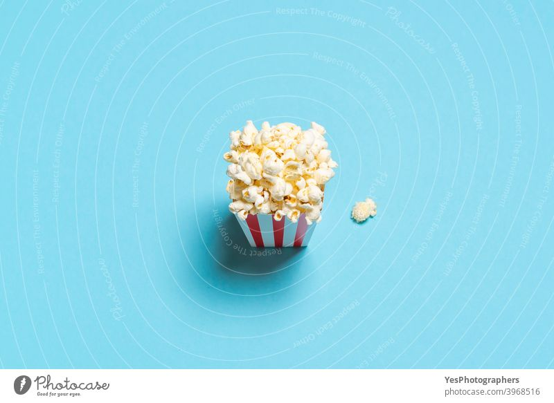 Popcorn box top view. Popcorn box isolated on a blue background. above view american appetizer bucket cardboard box cinema classic comfort food container