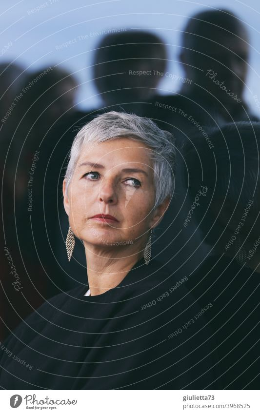 Thoughtful attractive middle-aged woman, with great grey short hairstyle, alone among many people Woman Adults Female senior Senior citizen Life 1 Human being