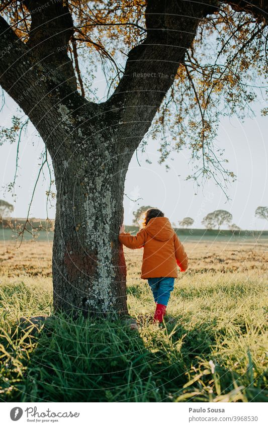 Rear view child near a tree Child Unrecognizable Playing Girl Nature Happiness Colour photo Day Human being Cute Lifestyle Leisure and hobbies Toddler Happy Joy
