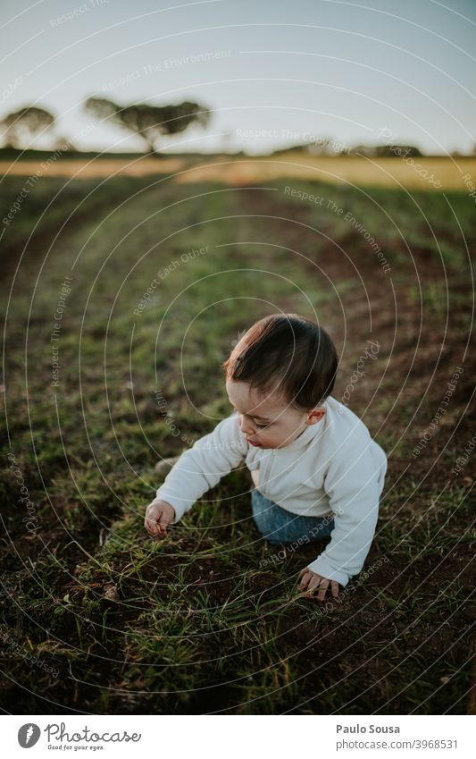 Toddler playing outdoors Authentic Nature Field Autumn Winter Day Calm explore Caucasian Child childhood Family & Relations Joy Playing 1 - 3 years Happiness