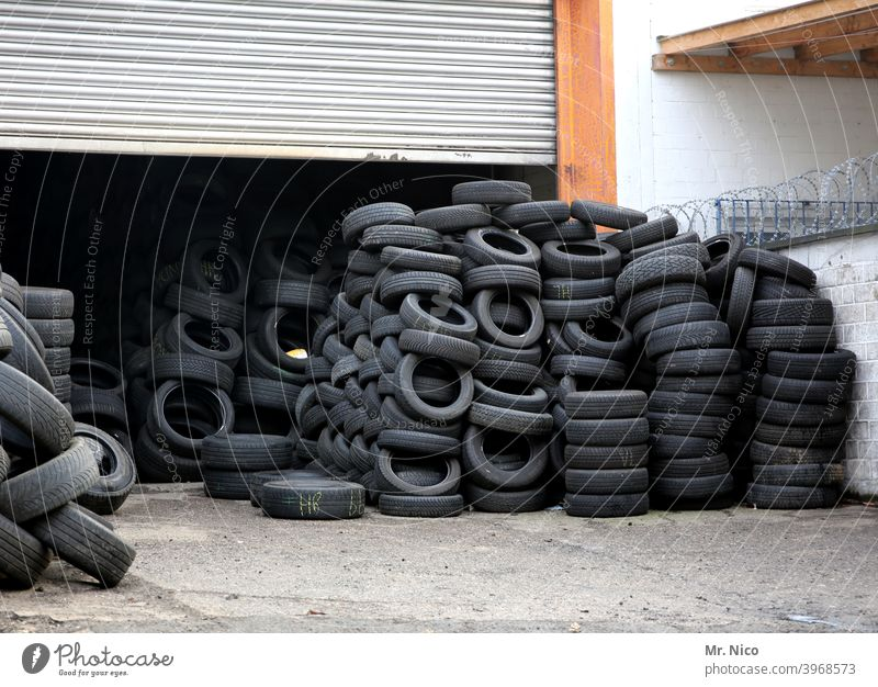 Tyre trade Tire Tire tread Rubber Black scrap tyres Recycling Scrap metal Disposal stacked Trash Waste management recycling yard Special waste Material Heap