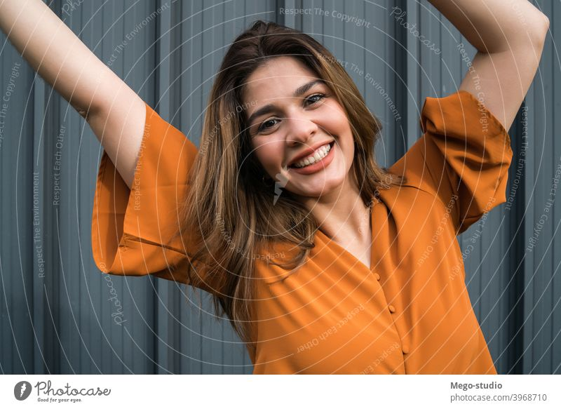 Portrait of young woman outdoors. portrait street celebrate female stylish celebrating urban lifestyle outside one adult person casual people pretty happy city