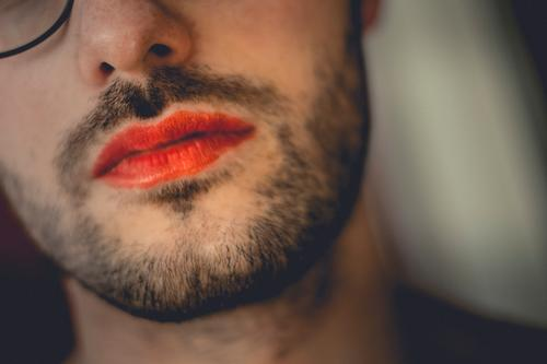 Breaking down gender roles. A person with a beard and red lipstick made up. Facial hair Lipstick masculine feminine Feminine Transgender trans crossdressing