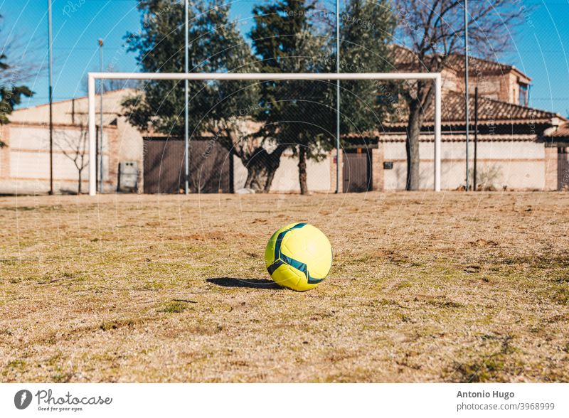 Yellow soccer ball placed in free throw position. Ground soccer field. yellow ground urban game football competition goal kick penalty league line pitch win