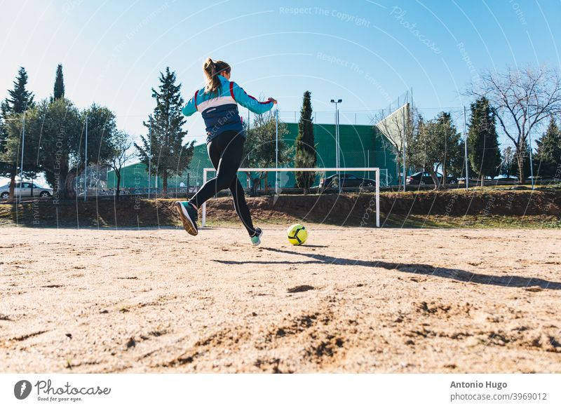 Woman shooting a free kick towards the goal. Ground soccer field. Female soccer concept. ready running feminine woman female blonde caucasian kicking penalty