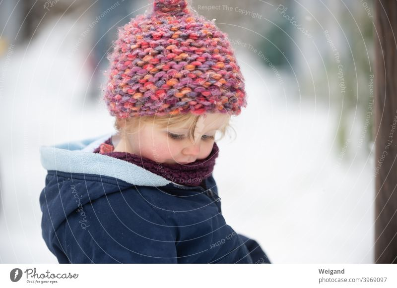 Little child in the snow Child Toddler Cap Snow Parenting Winter Cold Family