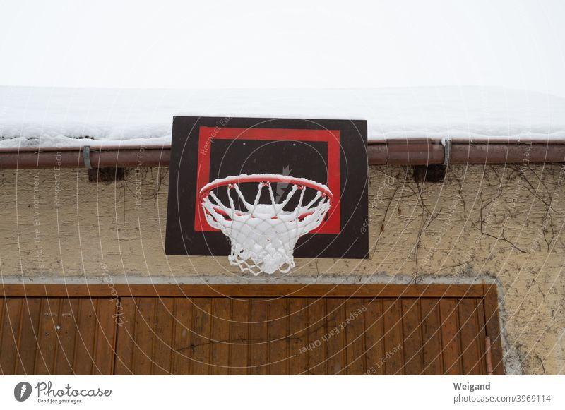 Basketball hoop in winter lockdown Basketball basket Infancy Sports Backyard Winter Snow bleak Gloomy Boredom Cold youthful