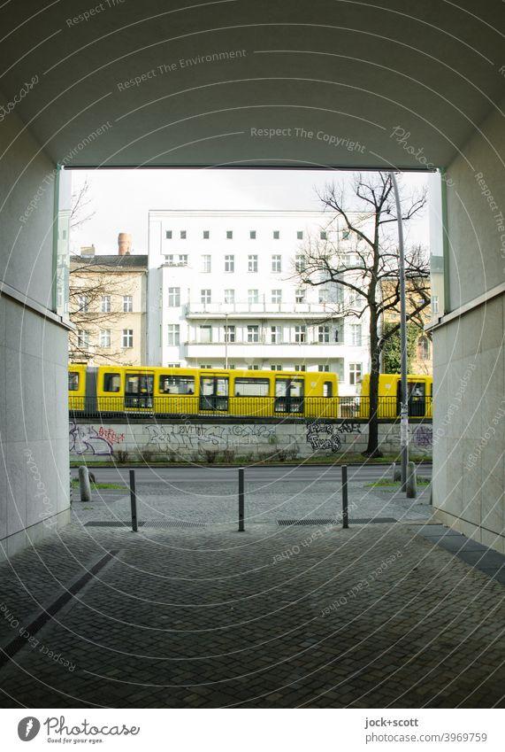 On a winter day the subway passes by in the direction of Mitte Schönhauser Allee Prenzlauer Berg Architecture Underground City Sidewalk Street