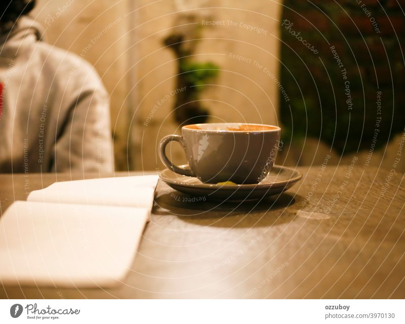 cup of cappucino at cafe mug table caffeine cappuccino drink background liquid white milk beverage empty hot latte breakfast brown night close closeup coffee