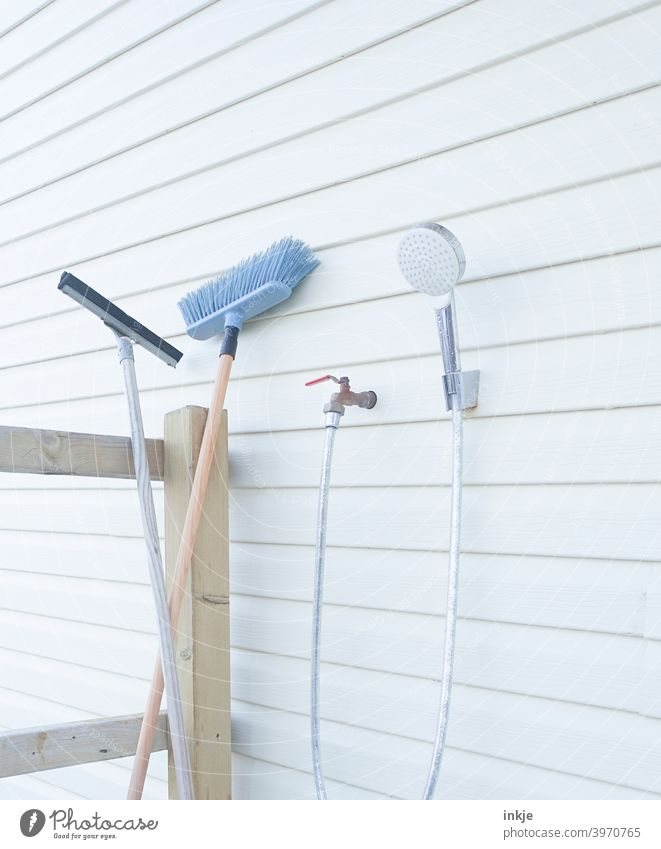 Cleaning utensils outdoor Colour photo Exterior shot Deserted polish Broom Shower head shower Water hose Veranda Bright pale clean neat White Household