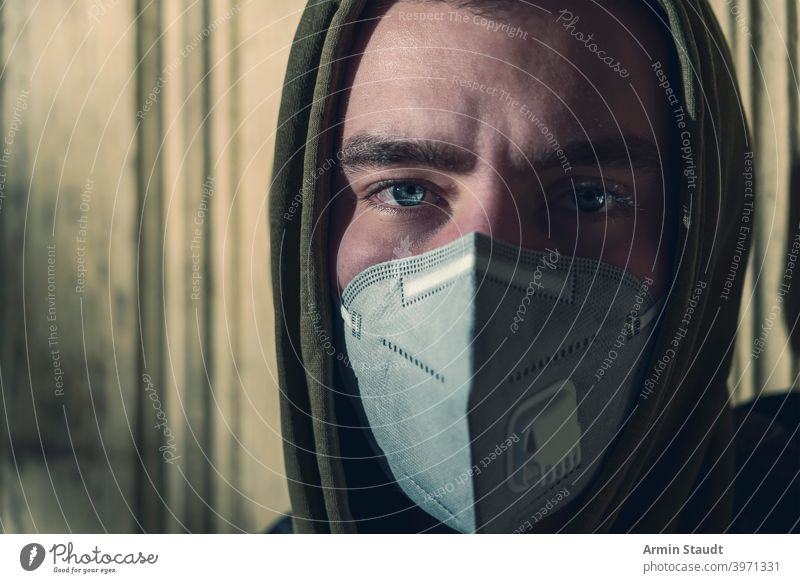 portrait of a young man with a FFP3 corona mask ffp3 protection pandemic pollution virus health care disease infection protective corona virus toxic caucasian