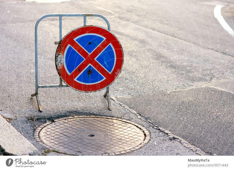 road sign asphalt street city sofia sewerage cover prohibition