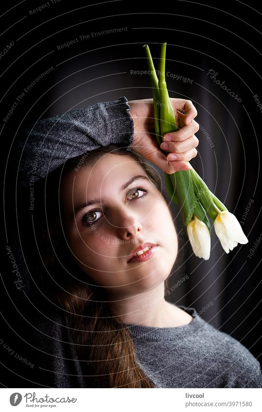 romantic teenager with tulips girl model young flower yellow tulips confined black and white at home pretty beauty real people sad attitude interior hand indoor