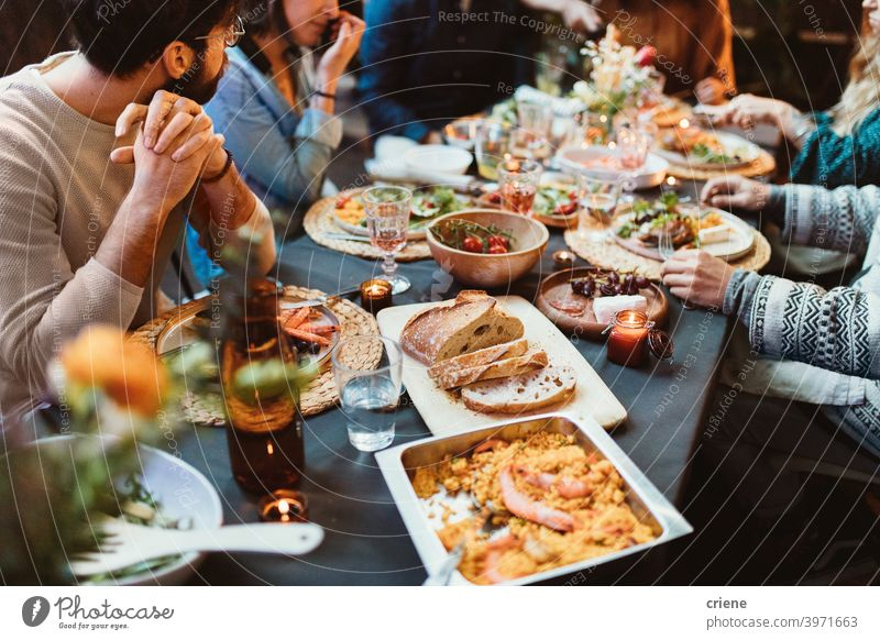 Garden Party dinner table with different food Adult Candid Outdoor Young Adult alcohol backyard bread celebrating chatting dinner party diversity drinking
