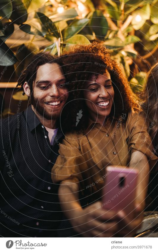 Happy couple taking selfie photo with phone together at party Candid Dating Girlfriend Happiness Heterosexual Couple Romance Smartphone Smiling Young Adult