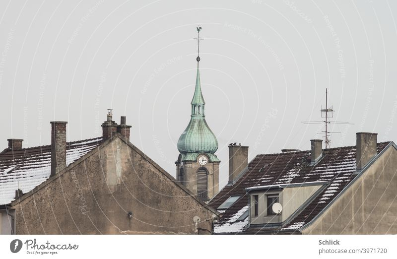 The church of notre Dame de la chapelle in Freyming-Merlebach Lorraine stands out between the roofs of two residential buildings Church France