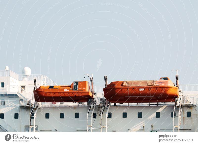 orange dinghies on a ship ferry Navigation Deck Orange Vacation & Travel Tourism Watercraft Trip Ferry Blanket Cruise Passenger ship On board Railing