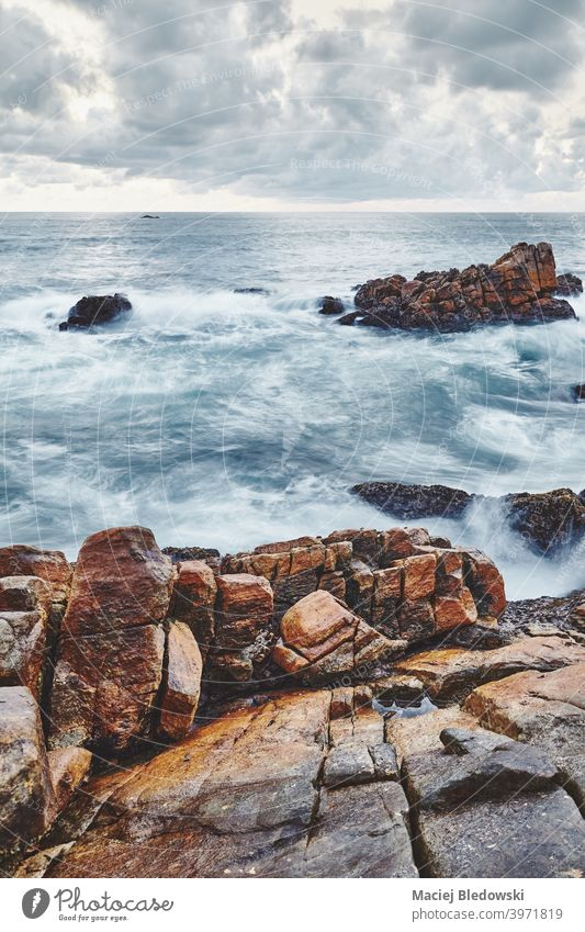 Rocky beach, color toned long exposure picture. sea rock water seascape wave ocean summer solitude filtered vacation sky no people nature coast island travel