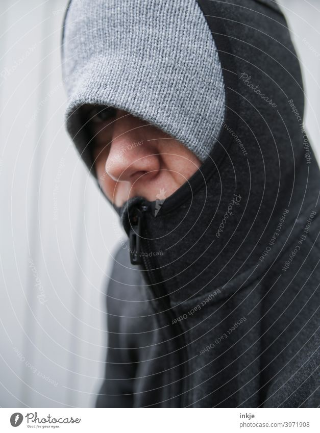 Close up of a freezing hooded woman Colour photo Close-up Exterior shot portrait portrait of a woman Anonymous Masked Authentic tired Boredom lockdown