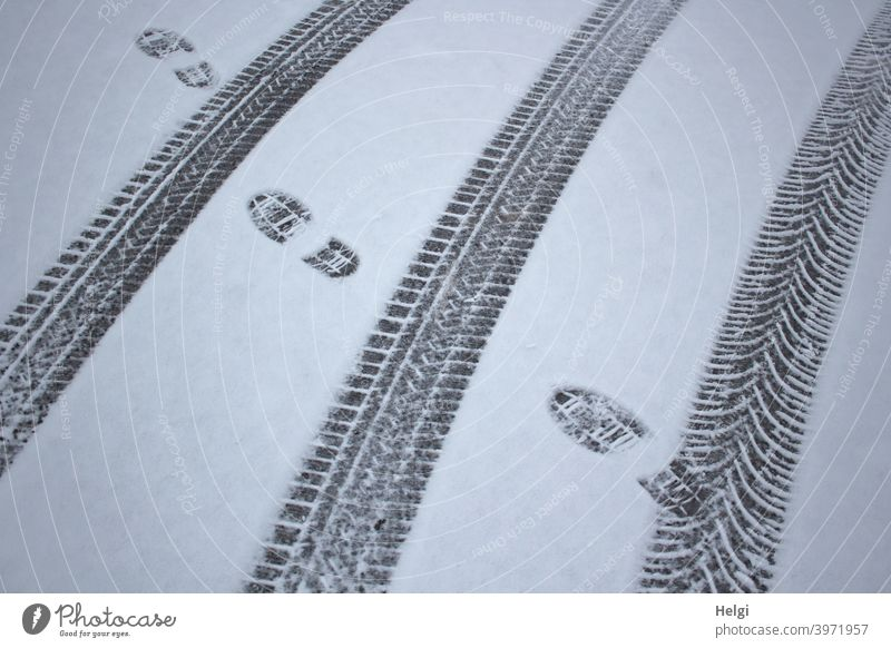 Tracks in the snow from car tires and shoes Snow Winter chill Skid marks footprints Imprint Pattern structure Cold Exterior shot Deserted White Snow track