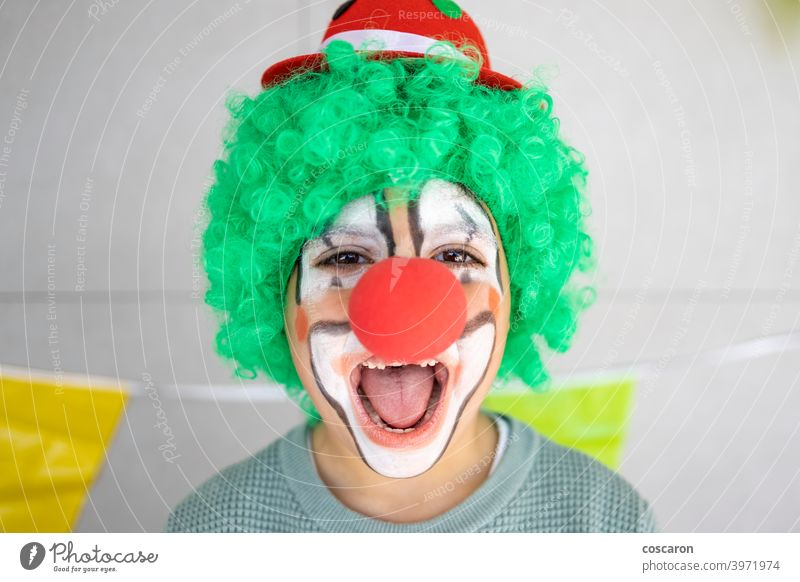 Little boy celebrating carnival at home dressed as a clown 1 april background birthday celebration cheerful child childhood close up colorful concept costume