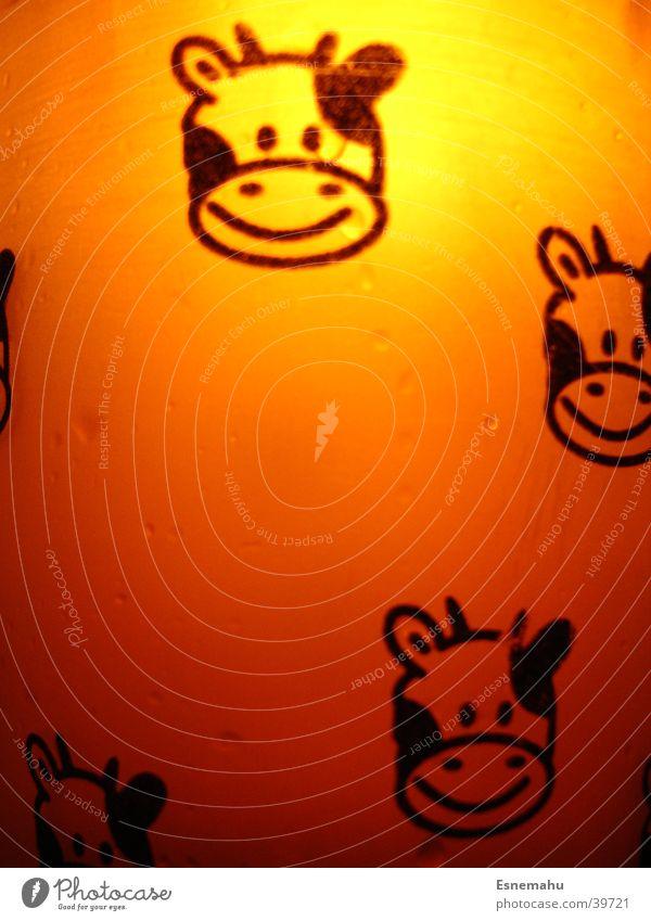 Cow cup in orange Mug Screen print White Light Translucent Lighting Black Dark Comic Living or residing Glass Orange Bright Close-up Detail Back-light Smiling