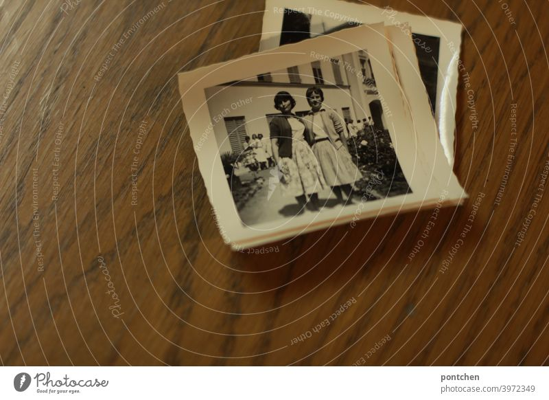 Old photos in black and white on wooden background. Time travel, past, found objects black-white 50s vintage Memory Black & white photo Nostalgia Photography