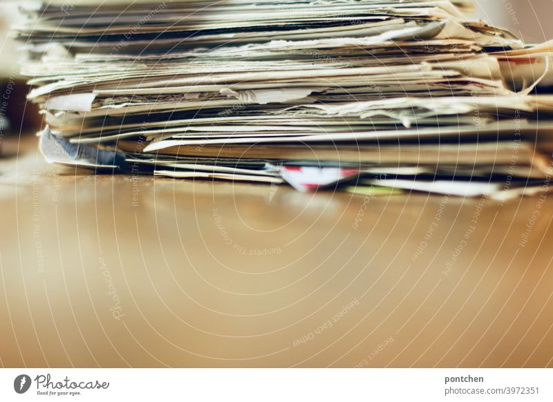 A pile of old letters and papers on a wooden base Letters Paper Old remembrances tidy out Dispose of Nostalgia Letter (Mail) Stack Untidy paperwork bureaucracy